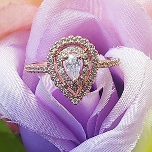 Jewelry - White Topaz on a Rose Gold Plated Band Ring Size 8